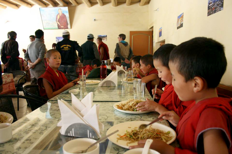 LITTLE MONKS AT <br>THIKSAY GOMPA SCHOOL <br>ENJOYING THE MEALS